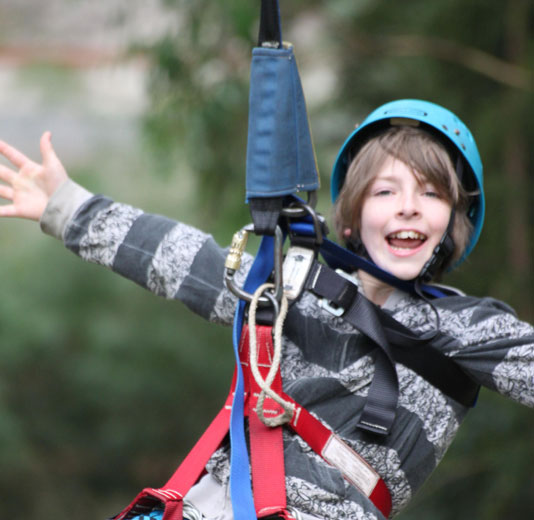 Younger boy on the flying fox